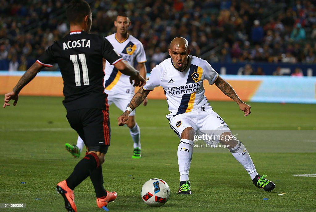 Nigel de Jong of Los Angeles Galaxy defends the play of Luciano Acosta of DC United during the first half of their MLS match at StubHub Center on...