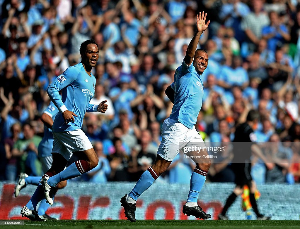 Nigel de Jong (R) of Manchester City celebrates scoring the opening goal during the Barclays Premier League match between Manchester City and West Ham United at the City of Manchester Stadium on May 1, 2011 in Manchester, England.