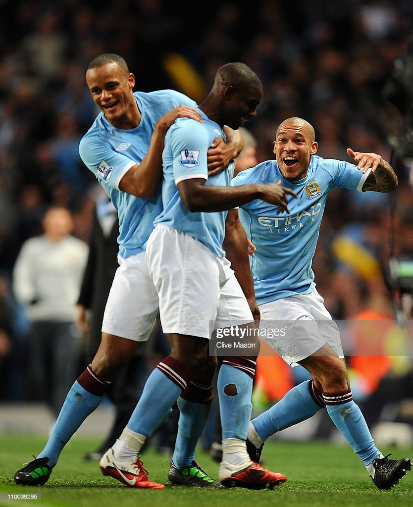 Nigel De Jong of Manchester City celebrates with goalscorer Micah Richards and teammate Vincent Kompany during the FA Cup sponsored by EOn Sixth...