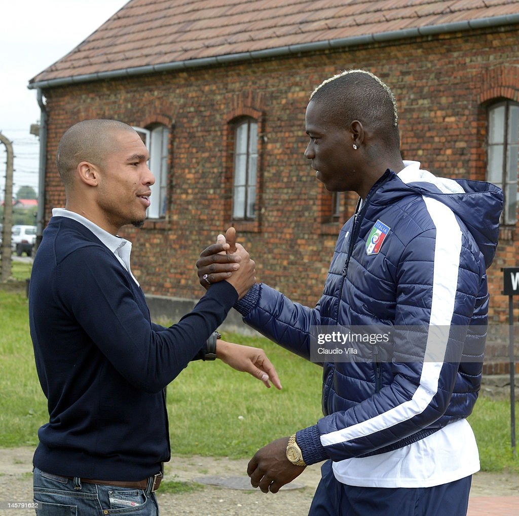 Nigel De Jong of Netherlands and <a gi-track='captionPersonalityLinkClicked' href=/galleries/search?phrase=Mario+Balotelli&family=editorial&specificpeople=4940446 ng-click='$event.stopPropagation()'>Mario Balotelli</a> greet each other during a visit by an Italian Football Association (FIGC) delegation to the Auschwitz-Birkenau memorial and former concentration camp, ahead of Euro 2012, on June 6, 2012 in Oswiecim, Poland.