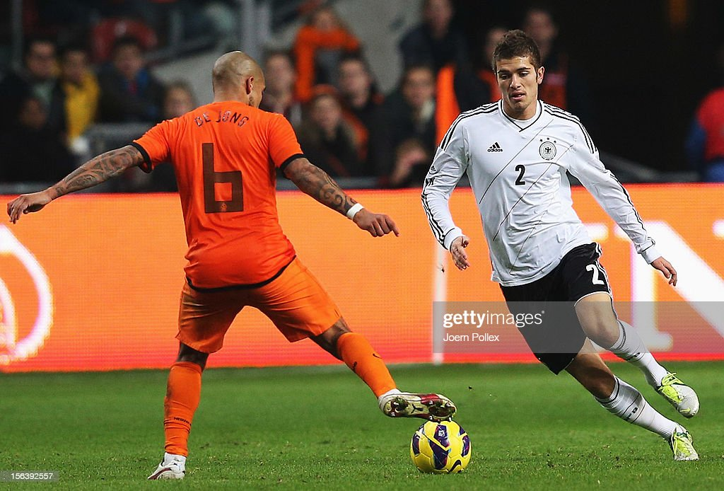 Nigel de Jong (L) of Netherlands and <a gi-track='captionPersonalityLinkClicked' href=/galleries/search?phrase=Roman+Neustaedter&family=editorial&specificpeople=5437402 ng-click='$event.stopPropagation()'>Roman Neustaedter</a> of Germany compete for the ball during the International Friendly match between Netherlands and Germany at Amsterdam Arena on November 14, 2012 in Amsterdam, Netherlands.