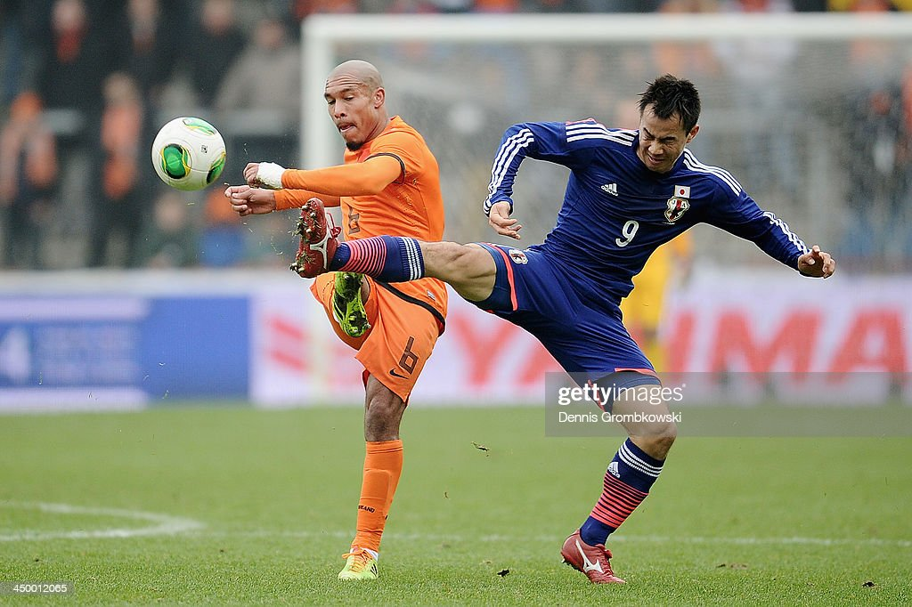 Nigel de Jong of Netherlands is challenged by Shinji Okazaki of Japan during the International Friendly match between the Netherlands and Japan on...