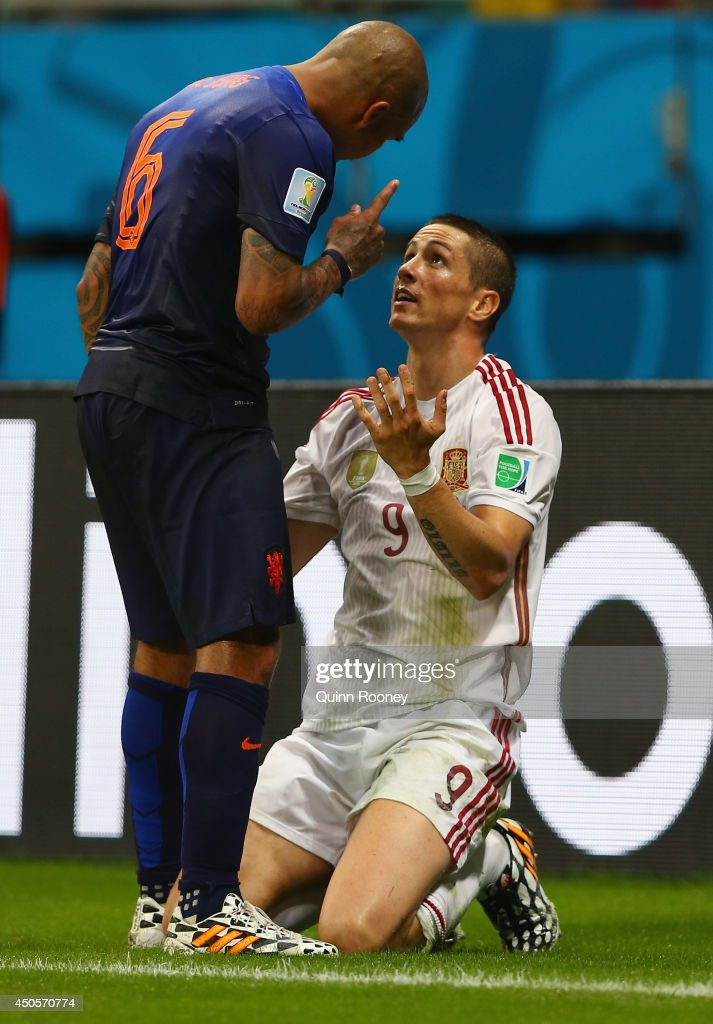Nigel de Jong of the Netherlands points a finger to Fernando Torres of Spain during the 2014 FIFA World Cup Brazil Group B match between Spain and...