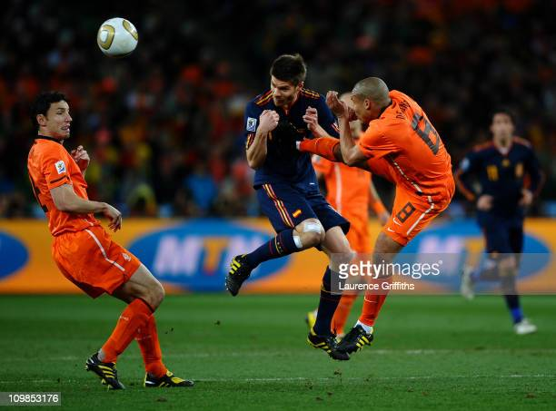 Nigel De Jong of the Netherlands tackles Xabi Alonso of Spain during the 2010 FIFA World Cup South Africa Final match between Netherlands and Spain...