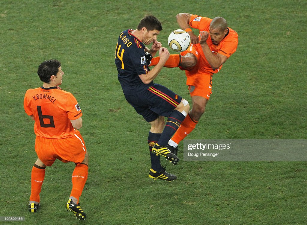 Nigel De Jong of the Netherlands tackles <a gi-track='captionPersonalityLinkClicked' href=/galleries/search?phrase=Xabi+Alonso&family=editorial&specificpeople=213833 ng-click='$event.stopPropagation()'>Xabi Alonso</a> of Spain with a kick in the chest during the 2010 FIFA World Cup South Africa Final match between Netherlands and Spain at Soccer City Stadium on July 11, 2010 in Johannesburg, South Africa.