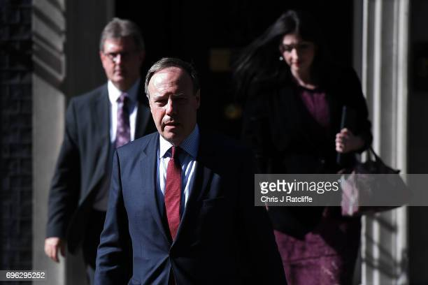 Nigel Dodds deputy leader of the Democratic Unionist Party walks with colleagues as he prepares to speak to the media outside 10 Downing Street on...