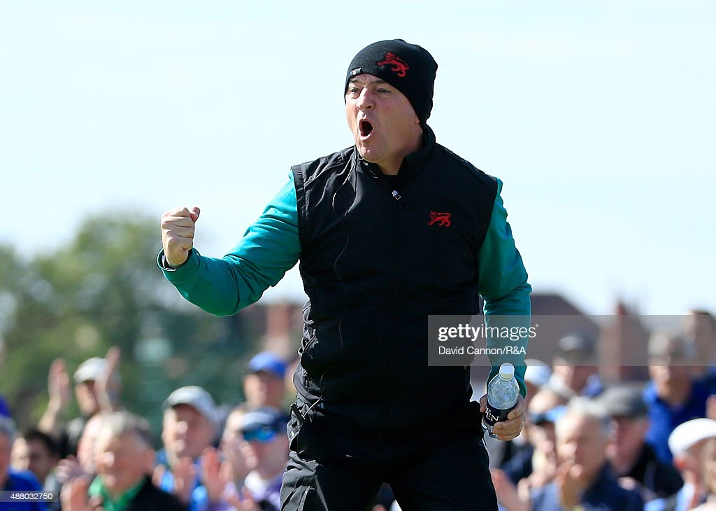 Nigel Edwards the Great Britain and Ireland team captain celebrates as Gary Hurley and Paul Dunne make a crucial putt on the 16th green during the...