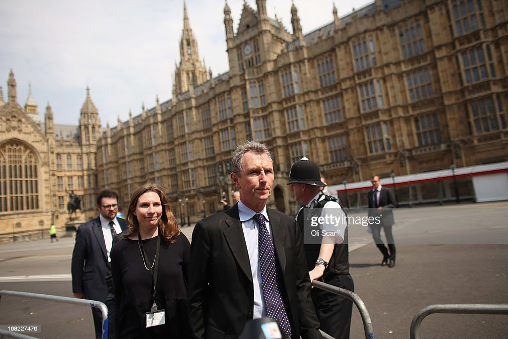 Nigel Evans (C), the Deputy Commons Speaker who was arrested at the weekend over rape and sexual assault allegations, prepares to address the media in front of the Houses of Parliament on May 7, 2013 in London, England. Mr Evans, the Conservative MP for Ribble Valley in Lancashire, has been questioned about alleged attacks on two men, something which he strenuously denies.