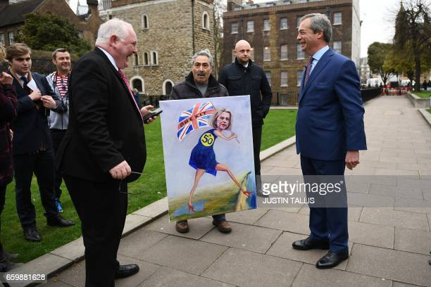 Nigel Farage former Leader of the United Kingdom Independence Party reacts after giving a television interview near the Houses of Parliament in...