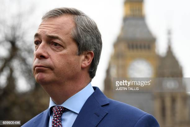 Nigel Farage former Leader of the United Kingdom Independence Party reacts as he gives a television interview outside the Houses of Parliament in...