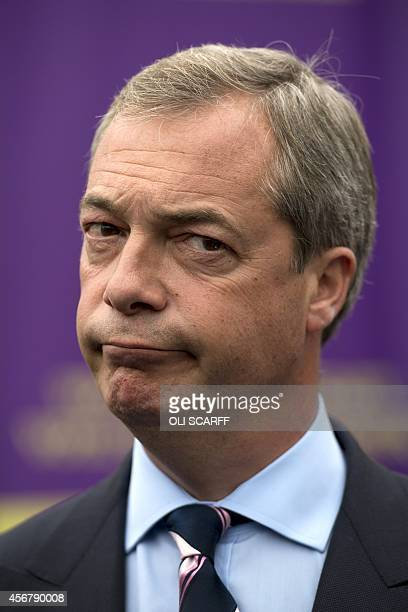 Nigel Farage leader of the UK Independence Party is pictured as he unveils a campaign poster ahead of the Heywood and Middleton byelection in Heywood...