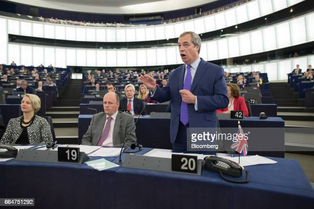 Nigel Farage member of European Parliament and former leader of the UK Independence Party gestures as he speaks ahead of vote the UK's Brexit...
