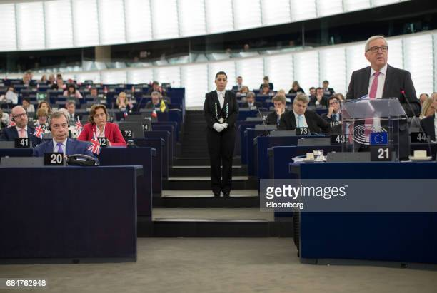 Nigel Farage member of European Parliament and former leader of the UK Independence Party left looks on as JeanClaude Juncker president of the...