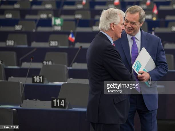 Nigel Farage member of European Parliament and former leader of the UK Independence Party right speaks with Michel Barnier the European Union's chief...