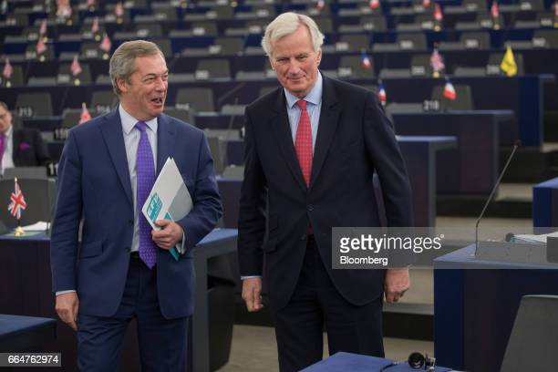 Nigel Farage member of European Parliament and former leader of the UK Independence Party left speaks with Michel Barnier the European Union's chief...