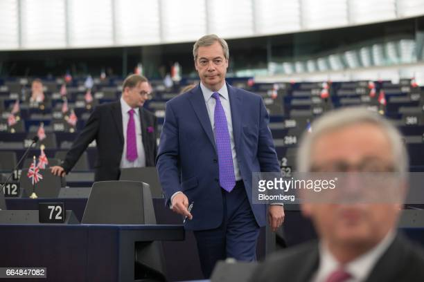 Nigel Farage member of European Parliament and former leader of the UK Independence Party center arrives ahead of a vote on the UK's Brexit...