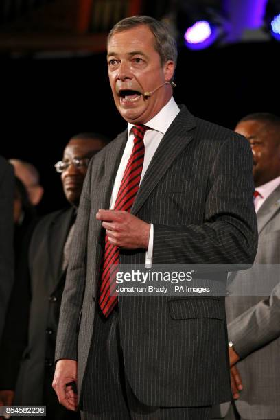 Nigel Farage speaks on stage during a UKIP rally held at the Emmanuel Centre London