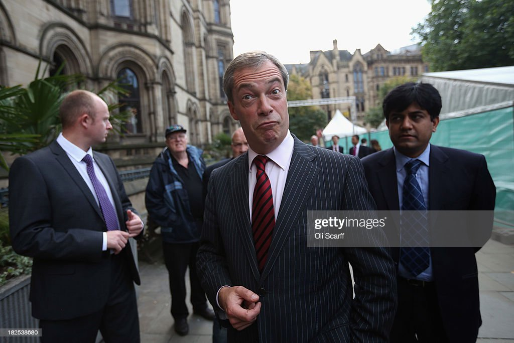 <a gi-track='captionPersonalityLinkClicked' href=/galleries/search?phrase=Nigel+Farage&family=editorial&specificpeople=697991 ng-click='$event.stopPropagation()'>Nigel Farage</a> (C), the leader of the UK Independence Party, arrives to speak at a fringe event to the second day of the Conservative Party Conference in Manchester Town Hall on September 30, 2013 in Manchester, England. Chancellor of the Exchequer George Osborne has unveiled a Government plan for long-term unemployed people to undertake work placements in order to receive their benefits.