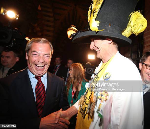 Nigel Farage UKIP Leader and Nick 'The Flying' Brick Monster Raving Looney Party during the Newark byelection count at Kelham Hall Newark