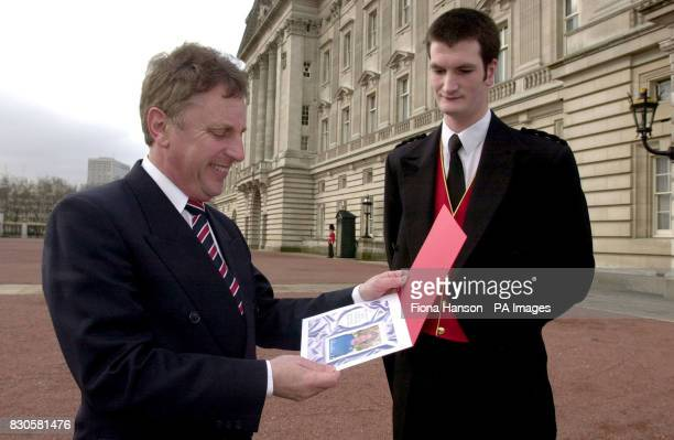 Nigel Fordham Head of the Crown Agents Stamp Bureau collects artwork approved by the Queen from Buckingham Palace footman George Chopping April 20...