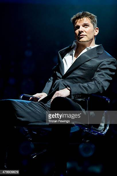 Nigel Harman as Simon Cowell during a photocall for 'I Can't Sing The X Factor Musical' at London Palladium on March 21 2014 in London England