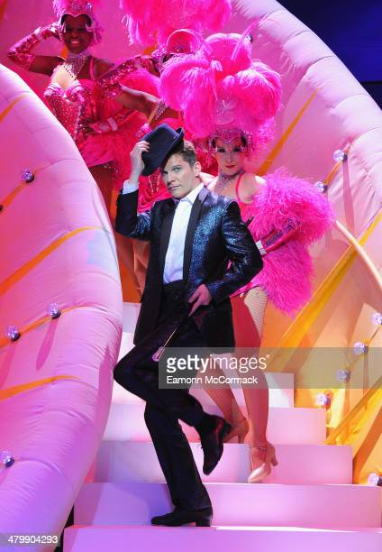 Nigel Harman plays 'Simon' during a photocall for 'I Can't Sing The X Factor Musical' at London Palladium on March 21 2014 in London England