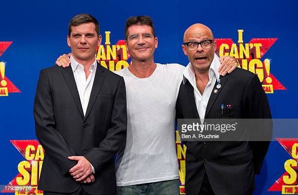 Nigel Harman Simon Cowell and Harry Hill attend a photocall to launch 'I Can't Sing The X Factor Musical' at RADA on September 2 2013 in London...