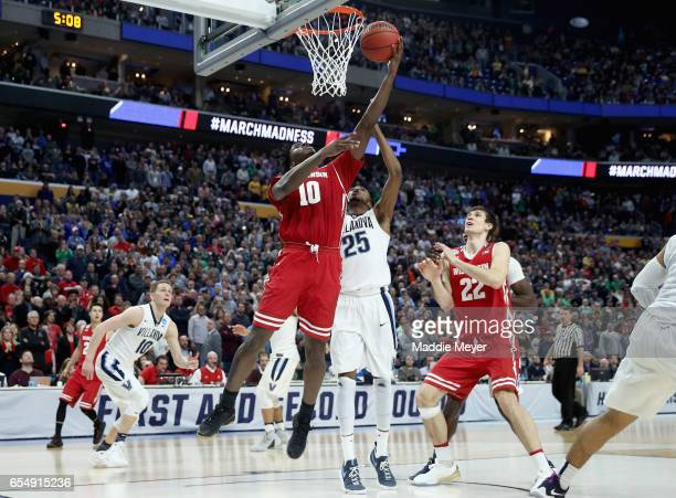 Nigel Hayes of the Wisconsin Badgers drives to the basket against Mikal Bridges of the Villanova Wildcats during the second round of the 2017 NCAA...