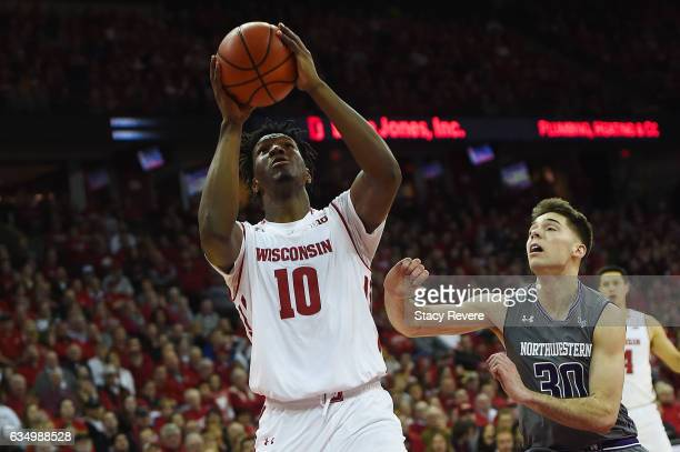 Nigel Hayes of the Wisconsin Badgers is defended by Bryant McIntosh of the Northwestern Wildcats during the second half of a game at the Kohl Center...