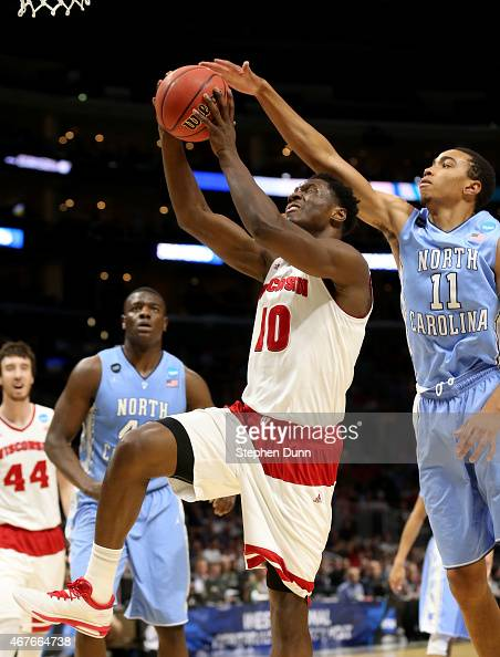 Nigel Hayes of the Wisconsin Badgers shis blocked from behind by Brice Johnson of the North Carolina Tar Heels in the first half during the West...