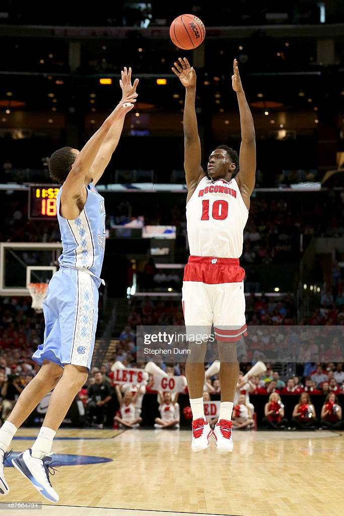 Nigel Hayes of the Wisconsin Badgers shoots the ball against Brice Johnson of the North Carolina Tar Heels in the first half during the West Regional...