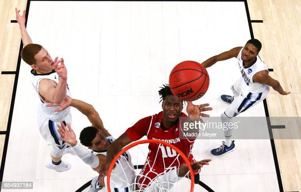 Nigel Hayes of the Wisconsin Badgers takes a shot against Josh Hart of the Villanova Wildcats during the second round of the 2017 NCAA Men's...