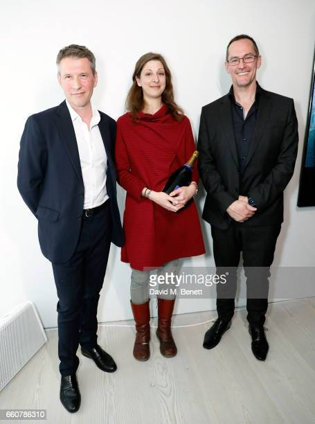 Nigel Hurst Dawn Woolley and Andrew Garrihy attend the 'From Selfie To SelfExpression Exhibition presented by Huawei in partnership with the Saatchi...