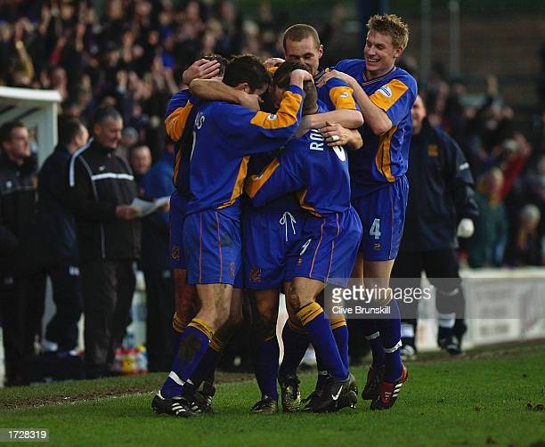 Nigel Jemson of Shrewsbury Town celebrates scoring with team mates during the FA Cup Third Round match between Shrewsbury Town and Everton held on...