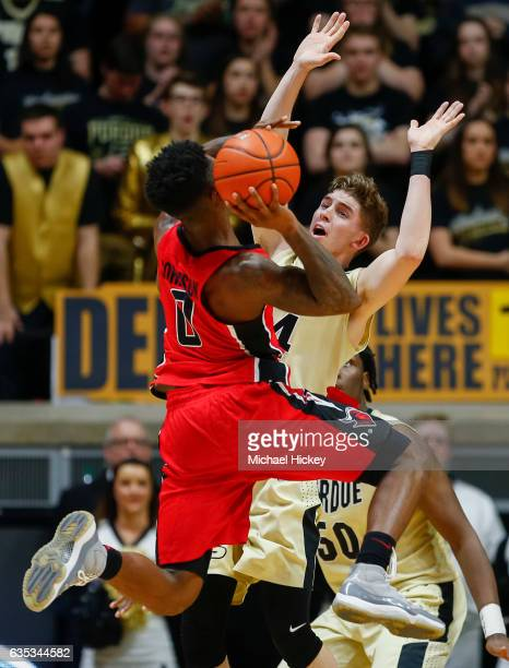 Nigel Johnson of the Rutgers Scarlet Knights tries to shoot the ball against the defense of Ryan Cline of the Purdue Boilermakers at Mackey Arena on...