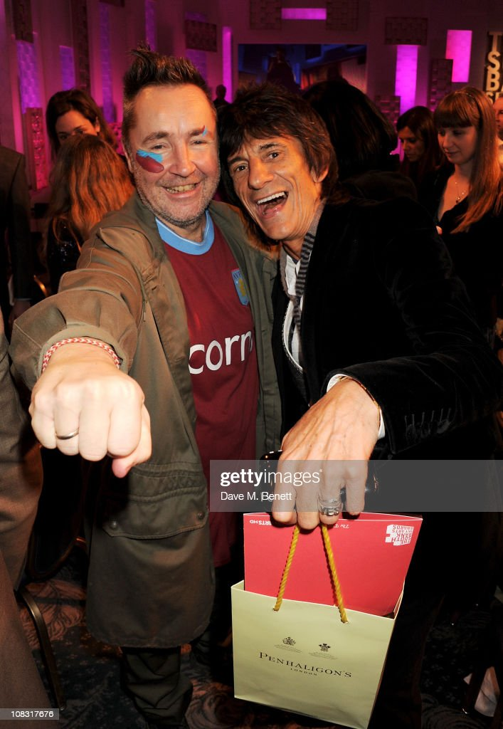 <a gi-track='captionPersonalityLinkClicked' href=/galleries/search?phrase=Nigel+Kennedy&family=editorial&specificpeople=991974 ng-click='$event.stopPropagation()'>Nigel Kennedy</a> (L) and Ronnie Wood attend the South Bank Sky Arts Awards at The Dorchester on January 25, 2011 in London, England.
