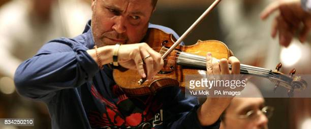 Nigel Kennedy performing with the Royal Philharmonic Orchestra during rehearsals of Elgar's Violin Concerto ahead of their concert at the Royal...