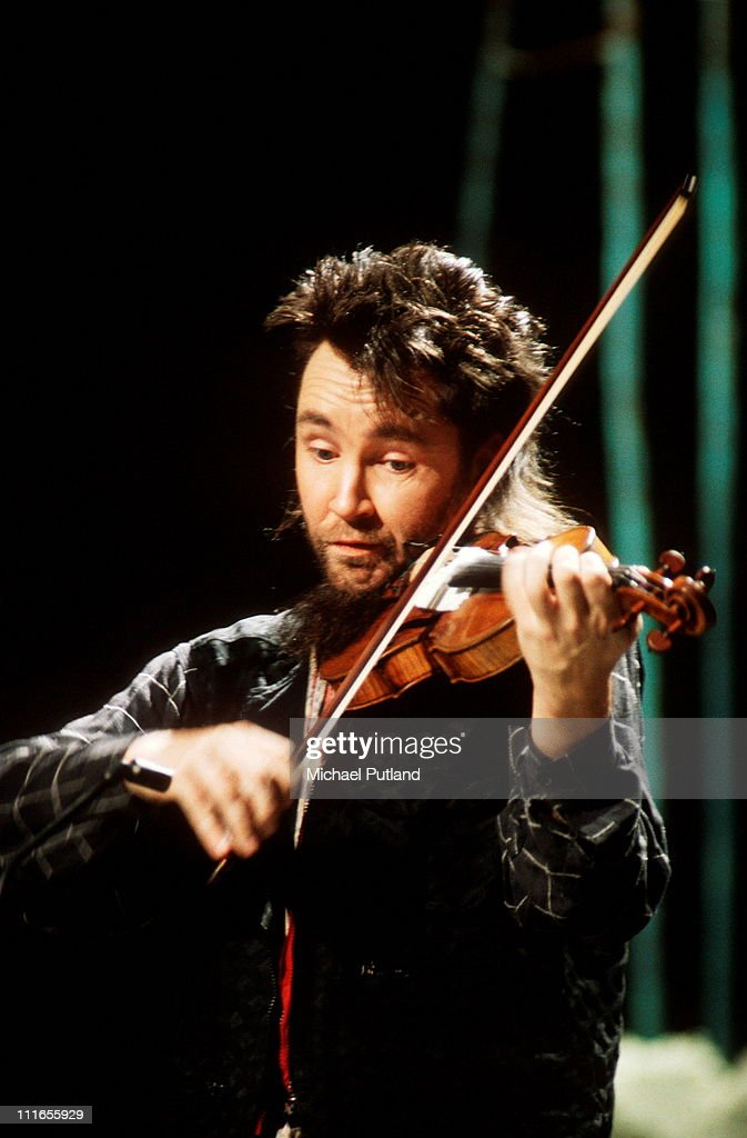 <a gi-track='captionPersonalityLinkClicked' href=/galleries/search?phrase=Nigel+Kennedy&family=editorial&specificpeople=991974 ng-click='$event.stopPropagation()'>Nigel Kennedy</a> performs on stage, London, 1993.