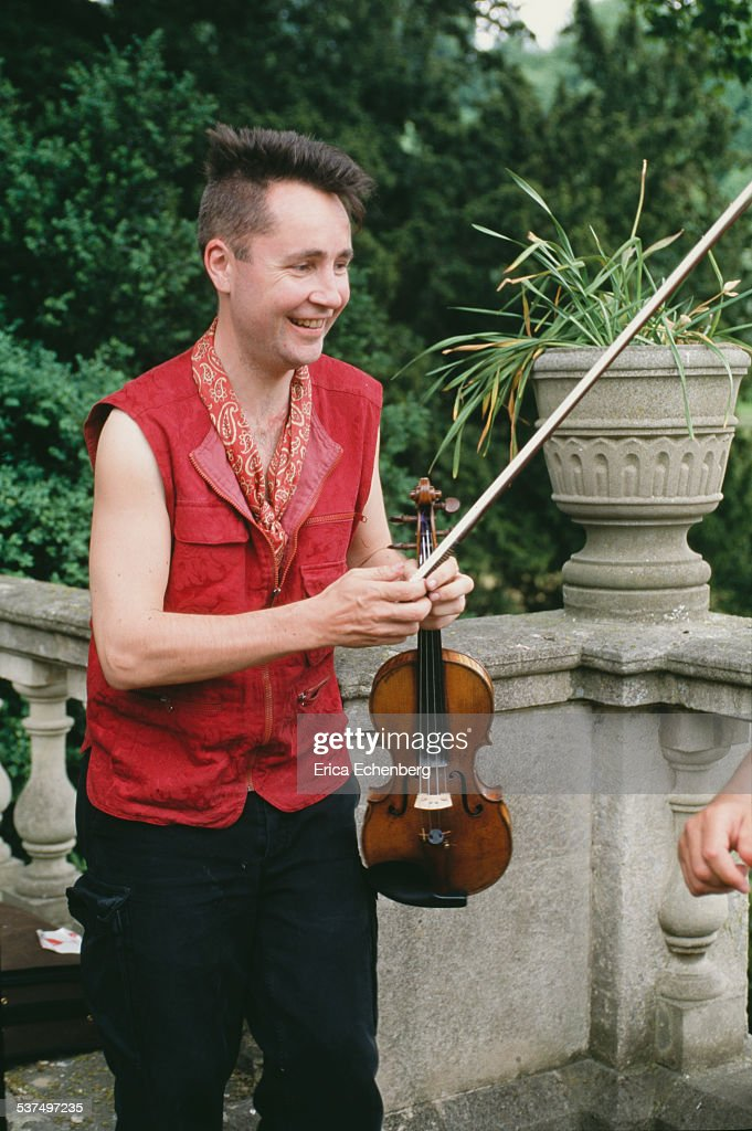 <a gi-track='captionPersonalityLinkClicked' href=/galleries/search?phrase=Nigel+Kennedy&family=editorial&specificpeople=991974 ng-click='$event.stopPropagation()'>Nigel Kennedy</a>, portrait, promoting his album 'Kafka', Castle Combe, Wiltshire, United Kingdom, 1996.