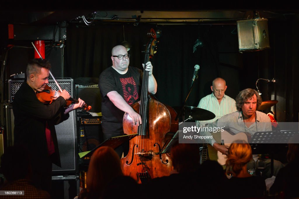 <a gi-track='captionPersonalityLinkClicked' href=/galleries/search?phrase=Nigel+Kennedy&family=editorial&specificpeople=991974 ng-click='$event.stopPropagation()'>Nigel Kennedy</a>, Yaron Stavri, Mark Fletcher and John Etheridge perform on stage at Pizza Express Jazz Club on September 10, 2013 in London, England.