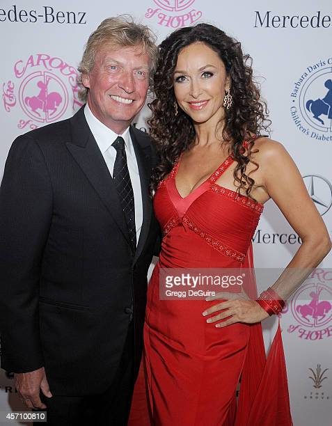Nigel Lythgoe and actress Sofia Milos arrive at the 2014 Carousel Of Hope Ball Presented By MercedesBenz at The Beverly Hilton Hotel on October 11...