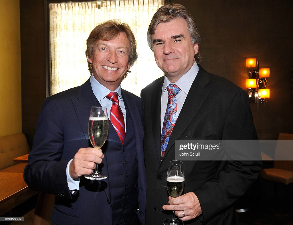 Nigel Lythgoe and Bob Peirce attend a Golden Globe lunch hosted by BritWeek chairman Bob Peirce honoring Julian Fellowes, Gareth Neame and Michelle Dockery at Four Seasons Hotel Los Angeles at Beverly Hills on January 12, 2013 in Beverly Hills, California.