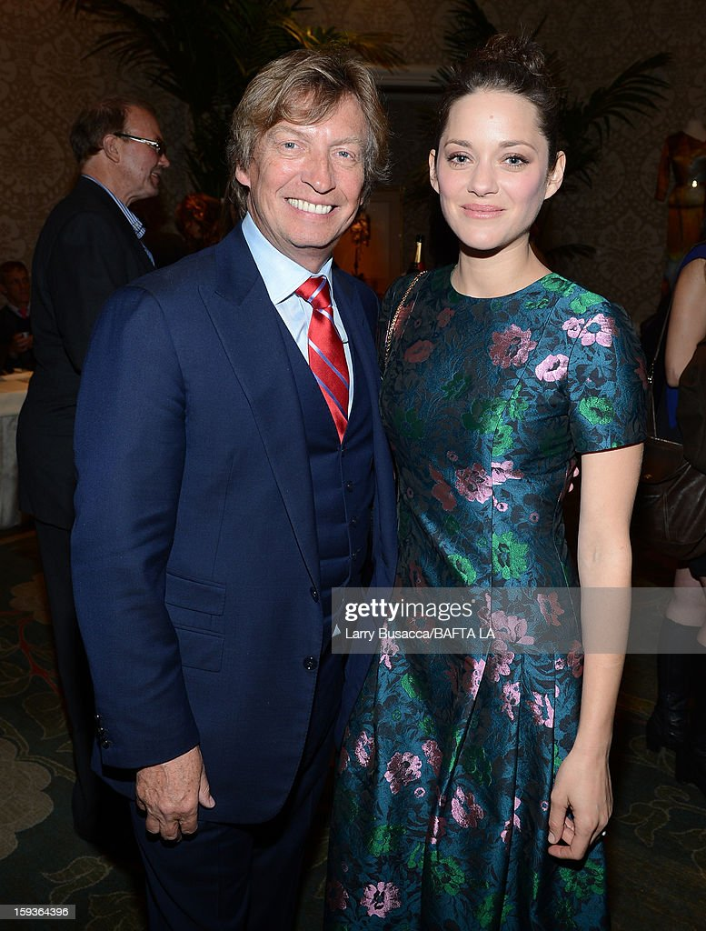 Nigel Lythgoe and Marion Cotillard attend the BAFTA Los Angeles 2013 Awards Season Tea Party held at the Four Seasons Hotel Los Angeles on January 12, 2013 in Los Angeles, California.