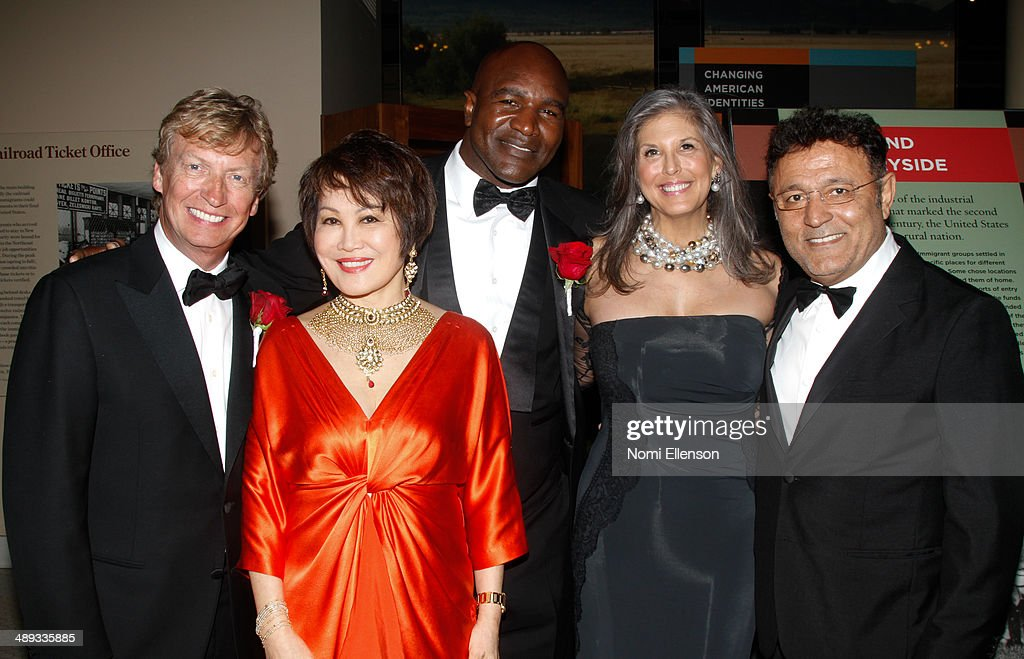 <a gi-track='captionPersonalityLinkClicked' href=/galleries/search?phrase=Nigel+Lythgoe&family=editorial&specificpeople=736462 ng-click='$event.stopPropagation()'>Nigel Lythgoe</a>, Yue-Sai Kan, <a gi-track='captionPersonalityLinkClicked' href=/galleries/search?phrase=Evander+Holyfield&family=editorial&specificpeople=194938 ng-click='$event.stopPropagation()'>Evander Holyfield</a>, Joan Hornig, and <a gi-track='captionPersonalityLinkClicked' href=/galleries/search?phrase=Elie+Tahari+-+Fashion+Designer&family=editorial&specificpeople=6746036 ng-click='$event.stopPropagation()'>Elie Tahari</a> attend the 2014 Ellis Island Medals Of Honor at Ellis Island on May 10, 2014 in New York City.
