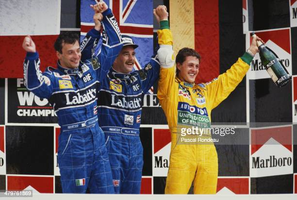 Nigel Mansell of Great Britain driver of the Canon Williams Renault Williams FW14B Renault RS3C/RS4 V10 celebrates winning with 2nd placed team mate...