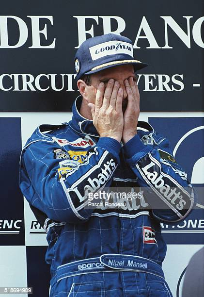 Nigel Mansell of Great Britain driver of the Canon Williams Renault Williams FW14 Renault V10 after winning his first race of the season at the...