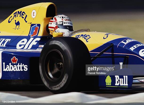 Nigel Mansell of Great Britain drives the Canon Williams Renaul Williams FW14 Renault 35 V10 during the Coca Cola Italian Grand Prix on 8th September...