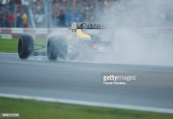 Nigel Mansell of Great Britain drives the Canon Williams Williams FW12 Judd CV V8 in the rain to second place during the British Grand Prix on 10...