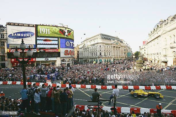 Nigel Mansell of Great Britain drives the Jordan Formula One car through the streets of London during the Formula One Regent Street Parade in Regent...