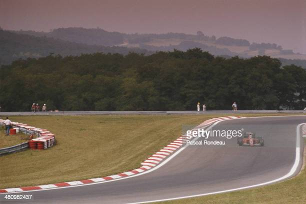 Nigel Mansell of Great Britain drives the Scuderia Ferrari SpA SEFAC Ferrari 640 Ferrari V12 during practice for the Hungarian Grand Prix on 12th...